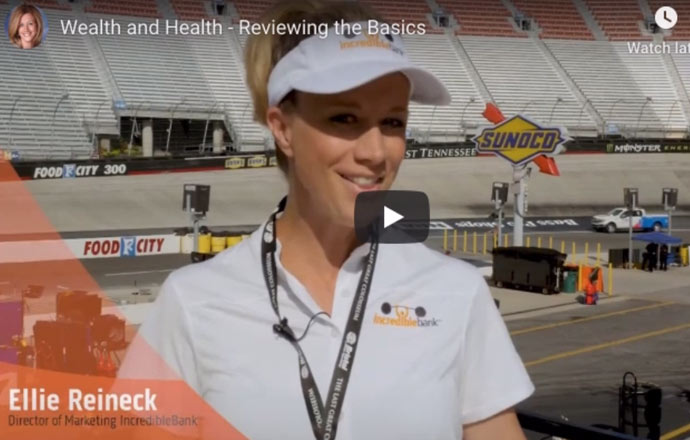 video of a woman being interviewed at a car race track