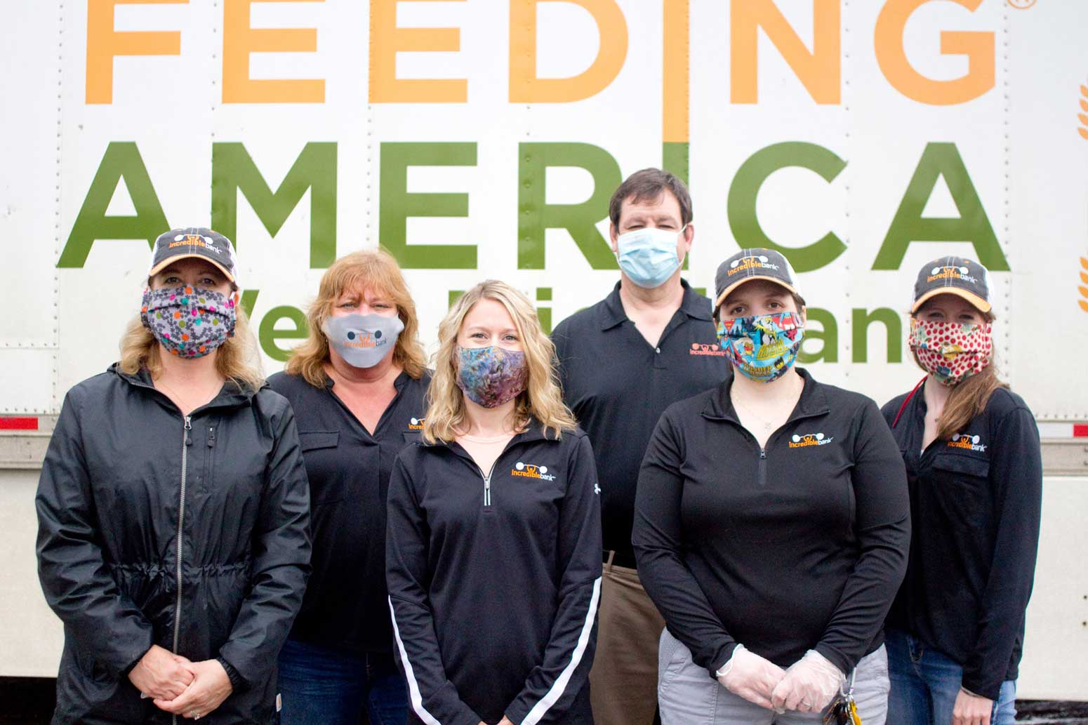 IncredibleBank staff in front of a Feeding America semi