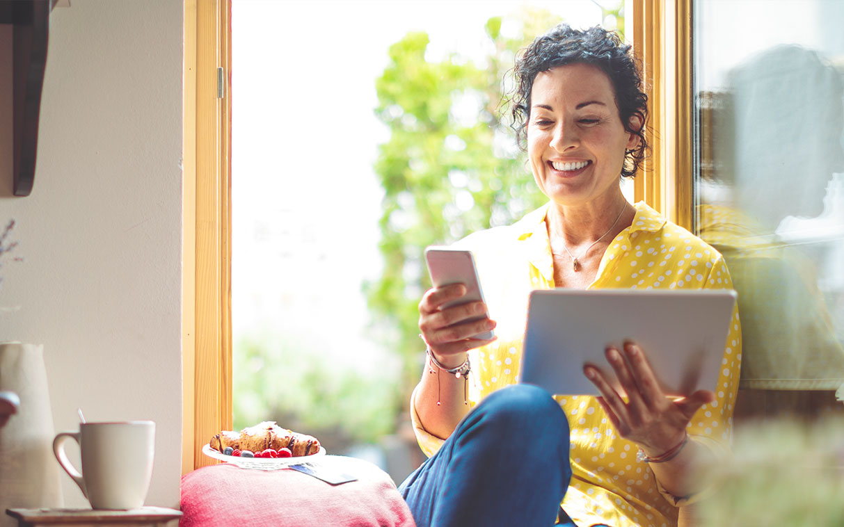 woman at home on mobile device