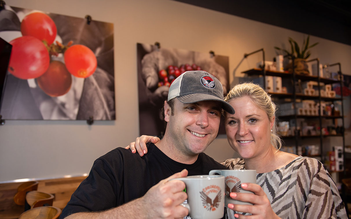 couple drinking coffee at a coffee shop
