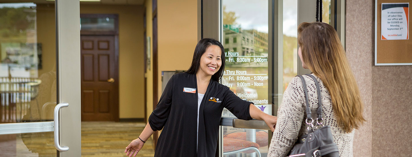 IncredibleBank staff opening door for customer