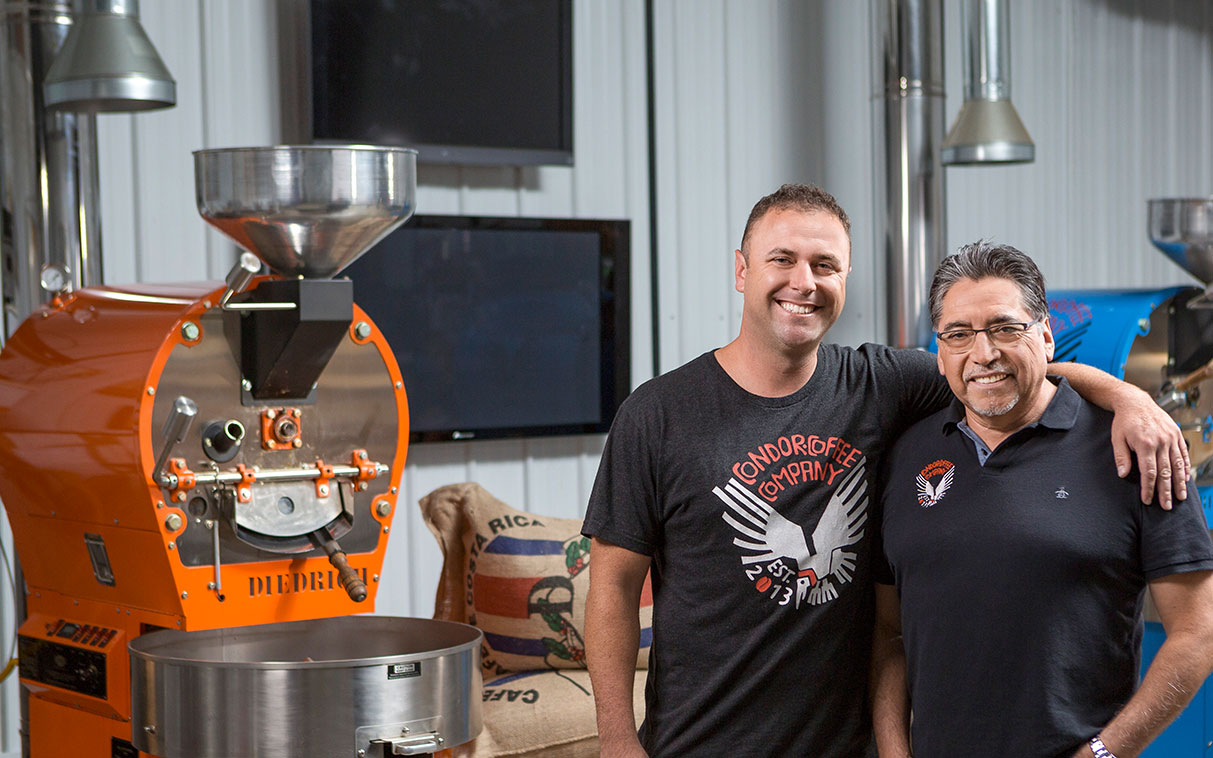 two men working at a coffee roaster